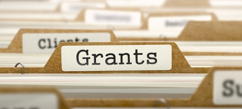 different-brown-files-focusing-on-file-labelled-grants-for-government-business-grants.jpeg