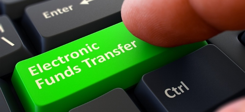 finger-on green-electronic-funds-transfer-button-using-real-time-bank-transfers.jpeg