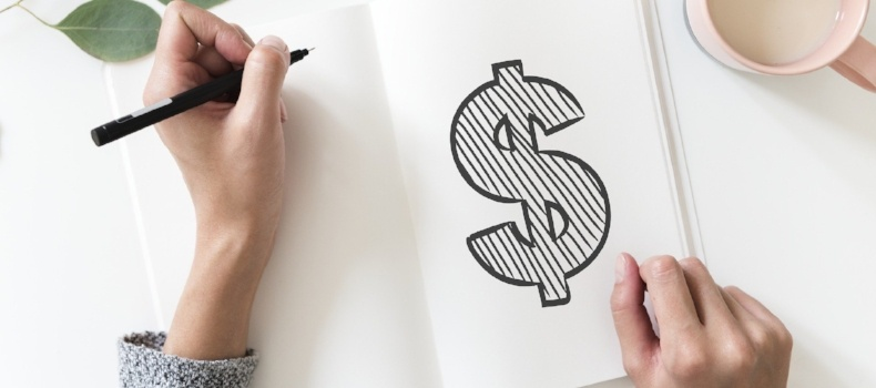 dollar-sign-on-paper-person-considering-business-finance-and-cashflow-lending